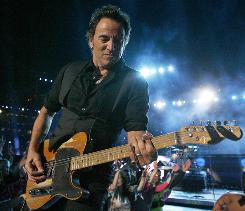 Bruce Springsteen performs during halftime of Super Bowl XLIII in Tampa.
