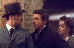 Sleuth be told: Jude Law, left, Robert Downey Jr. and Rachel McAdams star in Sherlock Holmes, due in November.