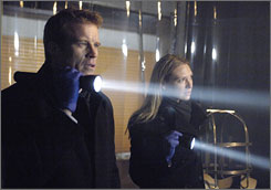 "Mark Valley and Anna Torv in a scene from ""Fringe"".  The couple married in December."