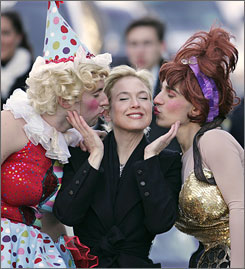 Renee Zellweger gets a little love from Hasty Pudding Theatricals actors in drag Tom Compton, left, and Dave Andersson  during the parade.
