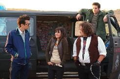 On the road: Jay Baruchel, left, Kristen Bell, Dan Fogler and Sam Huntington.