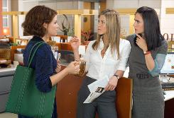 Girl talk: Ginnifer Goodwin, left, Jennifer Aniston and Jennifer Connelly are co-workers who just can't figure guys out.