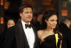 Brad Pitt and Angelina Jolie, who were BAFTA nominees, walk the red carpet at the awards Sunday in London.