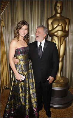 Jessica Biel, seen here with academy president Sid Ganis, continued the tradition of a hottie handing out Oscars to this year's technical winners.