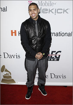 After attending Clive Davis' party on Saturday, Chris Brown was accused of attacking a woman in a car later that night. He was being booked when he was supposed to be walking the Grammy red carpet. Girlfriend Rihanna pulled out of the show with two hours to go.