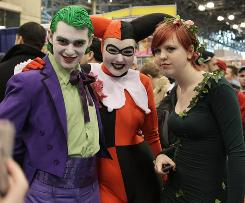 Fans pose as their favorite comic-book and science-fiction characters: The Joker, Harley Quinn and Poison Ivy.