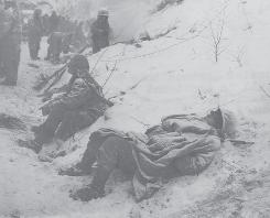 Fighting the Chinese and the conditions: Exhausted Marines slept where they fell after the Battle of Fox Hill, which took place in North Korea's well-below-freezing temperatures of late 1950.
