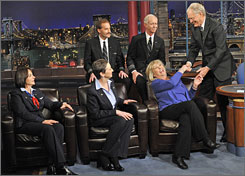 David Letterman shakes hands with flight attendant Doreen Welsh, as he thanks the crew of U.S. Airways Flight 1549.