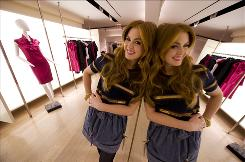 Isla Fisher plays Becky Bloomwood, whose life is one big spending spree, in Confessions of a Shopaholic. The comedy opens Friday. Here she's photographed at Barneys New York, where a scene was filmed.