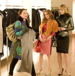 She'll take it! Isla Fisher, center, hits the stores with Kristin Scott Thomas, left, and Leslie Bibb.