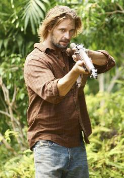 Taking aim: Lost's Sawyer, played by Josh Holloway, may be channeling some audience frustration this season.