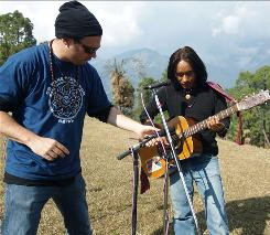Natural studio: Playing for Change founder Mark Johnson, left, records an Indian musician for the album.