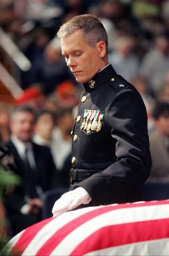 Kevin Bacon plays Lt. Colonel Michael Strobl, who escorts the coffin of a young Marine home.