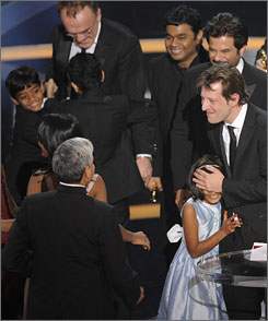 Producer Christian Colson celebrates with co-star Rubiana Ali, 9, and other cast and and crew after Slumdog Millionaire won best picture at Sunday's Academy Awards.