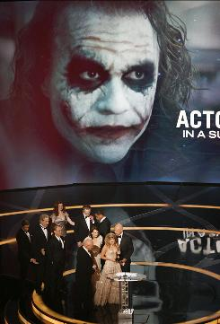 Heath Ledger's family  mother Sally Bell, sister Kate Ledger and father Kim Ledger  step up to the podium to accept the late actor's Oscar for The Dark Knight. The win was significant because it showed that a young actor could step into a complex role successfully.