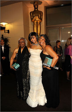 Party starters: Taraji P. Henson checks out the scene at the Governors Ball with her grandmother Patsie Ballard, left, and mother, Bernice Gordon.