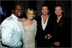 Idol affair: Randy Jackson, Carrie Underwood, Simon Cowell and Ryan Seacrest catch up at John's party.