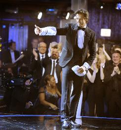 Thumbs up: Hugh Jackman was a hit as host of the Academy Awards, USA TODAY readers indicated.