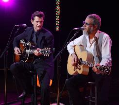 Chris Isaak, left, performs with upcoming guest Yusuf Islam (Cat Stevens).