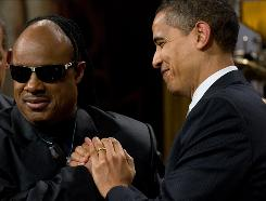 """Wonder week in Washington"": President Obama greets Stevie Wonder before giving him the Gershwin Prize on Wednesday."