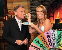 Wheel of Fortune's Pat Sajak and Vanna White are the icing on the cake. Now in its 26th season, the game show will air its 5,000th episode Friday.