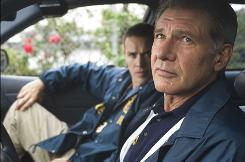 Harrison Ford, with Jamison Haase, plays a police officer who is rethinking his job rounding up undocumented workers in Crossing Over.