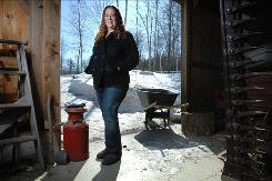 "Jodi Picoult, framed in the doorway of her barn in Hanover, N.H., writes about ""wrongful birth"" in Handle With Care, out Tuesday."