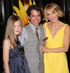 Film family: Huffman with Elle Fanning, who plays her daughter in Phoebe in Wonderland, and her neighbor Daniel Barnz, who wrote and directed the movie.
