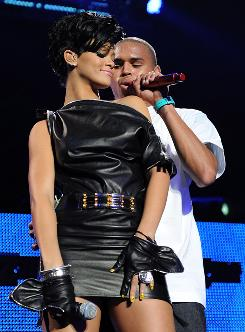 Chris Brown and Rihanna, shown performing at Madison Square Garden  in December, were together at Clive Davis' pre-Grammy party the night of Feb. 7.