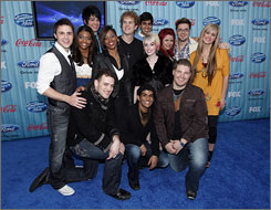 American Idol altered its routine Thursday, allowing 13 contestants (including four wildcards) into the finals.