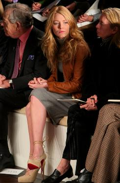 "Fashion fan Blake Lively is front-row center at the Ralph Lauren show Feb. 20 in New York. She will soon try her hand at her own clothes, too: ""I just got a Singer sewing machine."""