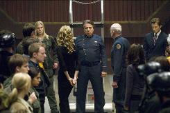 Katee Sackhoff, left, Kate Vernon, Edward James Olmos and Michael Hogan wrap up four seasons of Battlestar Galactica.