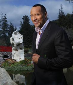 "Kids ""think of him as their buddy"": That's why Dwayne Johnson is so popular, says Carla Gugino, his co-star in Disney's Race to Witch Mountain, which opens Friday."