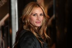 Julia Roberts, wearing Christian Dior, elicited screams from fans as she arrived for the showing of Duplicity at New York's Ziegfeld Theatre.