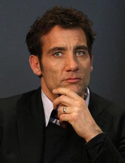 Clive Owen onstage during a Q&A visit to the Soho Apple store Tuesday in New York.  How did his name get into Duplicity director Tony Gilbert's head? Apparently George Clooney, Owen said.