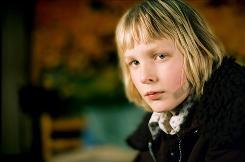 Bullied Oskar (Kare Hedebrant) befriends a pre-adolescent vampire girl in Let the Right One In.