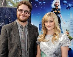 On the blue carpet: Seth Rogen and Reese Witherspoon arrive at Sunday's premiere.