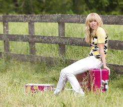 Who's that girl? Miley Cyrus' alter ego, Hannah Montana, sounds great on the soundtrack to her movie.