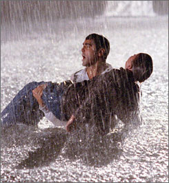 Drama outside the ER: Stranded on a rural road, Ross (George Clooney) frees an injured boy (Erik Von Detten) from a storm culvert.