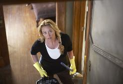 "Things aren't looking up: Virginia Madsen braves the creaky stairs in her ""possessed"" house in Connecticut."