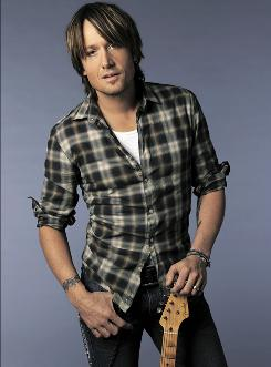 "Keith Urban's new album, Defying Gravity, arrives in stores Tuesday. ""It's a very up record,"" says Urban."