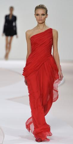 Among Valentino's exotically bold looks is this one-shoulder, chiffon, Grecian-style gown.