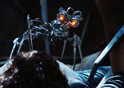 The spider-like droid called The Doctor has human hero Sam (Shia LaBeouf) pinned down.