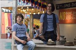 James (Jesse Eisenberg), left, and Joel (Martin Starr) work at a Pittsburgh theme park in Adventureland, the new film from Superbad director Greg Mottola.