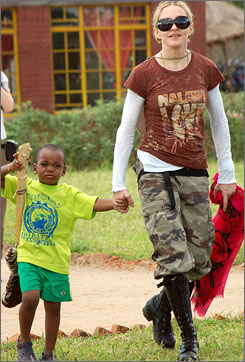 On Friday, Madonna, seen here visting a child care center with Malawi-born son David this week, learned her application to adopt a second child from that African nation has been denied. Authorities are enforcing a rule that requires prospective parents to live there for 18 months.