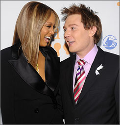 """It was interesting to be on the other side of the table and think of all these things that I went through in 2003,"" Clay Aiken, shown here with Tyra Banks, said."