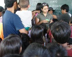 In the Philippines, All-USA student Andrea Andrada, of Elgin (Ill.) Community College, helps hand out free toys and school supplies in Iligan City. Andrada created the initiative.