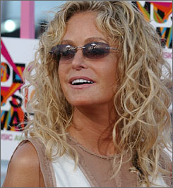 """A producer and friend of Farrah Fawcett says the actress is """"not unconscious. She is not on death's door. The family has not gathered to say goodbye."""""""