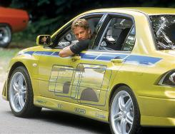 Making tracks: Paul Walker and a Mitsubishi in 2 Fast 2 Furious, which earned $127 million at the box office.