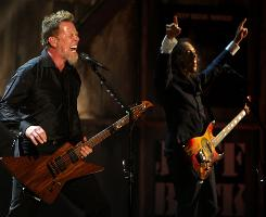 James Hetfield and Kirk Hammett of metal pioneers Metallica crank out some of band's classics Saturday night in Cleveland after being inducted into the Rock and Roll Hall of Fame.